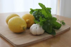 Garlic and mint on a chopping board